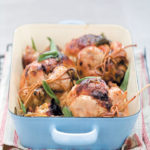 Roasted baby chickens stuffed with camembert and sage