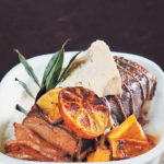 Roast rib of beef with baked citrus butternut and melted Gorgonzola