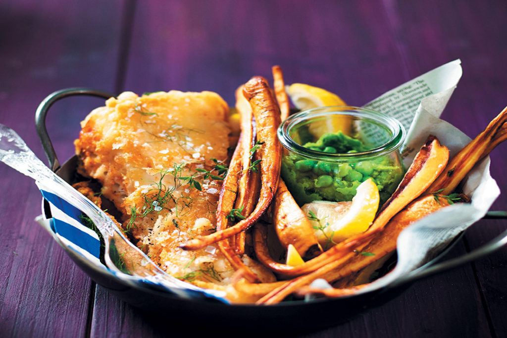 Cider-battered hake with parsnip chips and crushed peas recipe