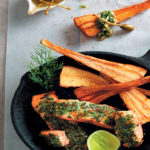 Herb-crusted rainbow trout, parsnip chips and salsa verde
