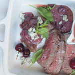 Roast fillet topped with blue cheese and served with a cherry and port sauce