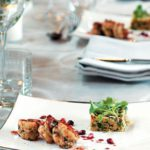 Sumac prawns with lemon tahini, pomegranate essence and couscous salad