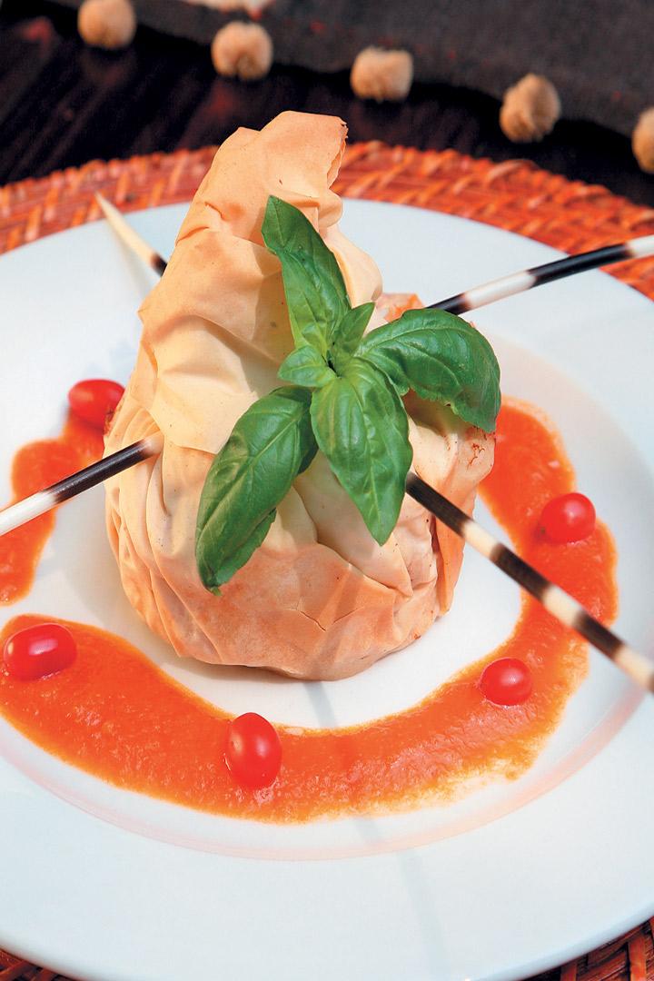 Three-cheese Mediterranean chicken in phyllo on tomato compote recipe