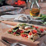 Basil pesto, roasted tomatoes and mozzarella open lasagne