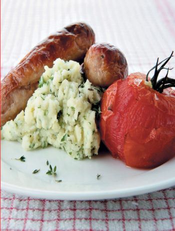 Bangers and herby mash with roasted vine tomatoes recipe