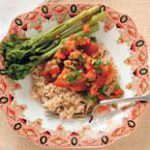 Grilled chicken breast with wild rice, broccoli and tomato-olive salsa