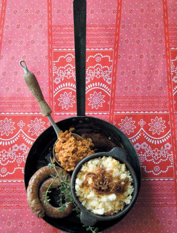Three-cheese pap served with saffron chakalaka and classic boerewors
