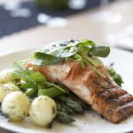 Seared salmon with fresh greens and herby potatoes