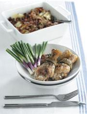 Pan-fried chicken with roast potatoes and bacon