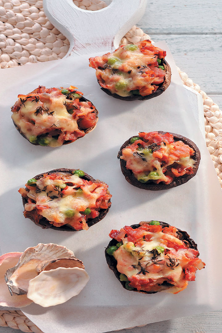 Black mushroom stuffed with bacon, peas, mozzarella and garlic recipe