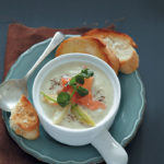 Fennel and potato soup with salmon and watercress