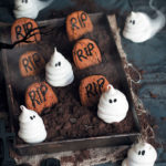 'Friendly ghost' meringues in a death-by-chocolate mousse graveyard with peanut butter tombstones
