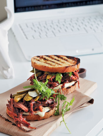 Grilled sandwich of BBQ beef brisket with mayo, gherkins and wild rocket recipe