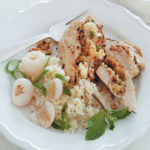 Litchi, pine nut and feta stuffed chicken breast with spring onion couscous