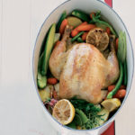 Organic pot roast chicken with lemons and vegetables