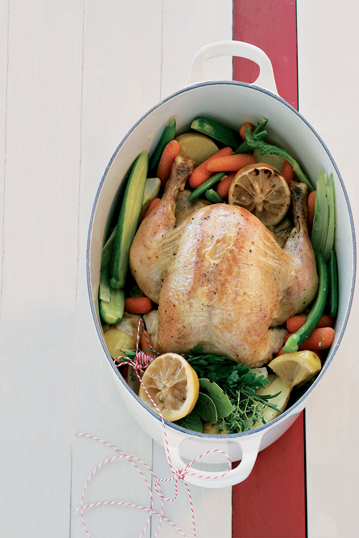 Organic pot roast chicken with lemons and vegetables recipe