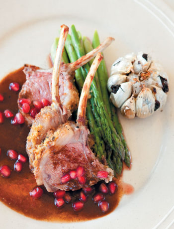Rack of lamb with Parmesan and nut crust served with a saffron and orange jus recipe