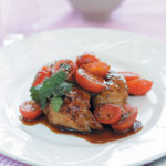Sticky chicken thighs with warm marinated Rosa tomatoes and chunky tzatziki