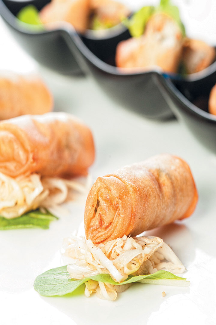 Thai chicken spring rolls on spicy pickled cabbage salad recipe