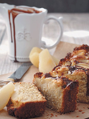 Pear, ginger and oat cake with a dark chocolate drizzle