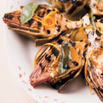 Chargrilled artichokes with crushed garlic and orange, honey and sage butter