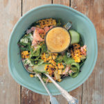 Chargrilled mealie, avocado and flaked salmon salad with spicy pineapple dressing