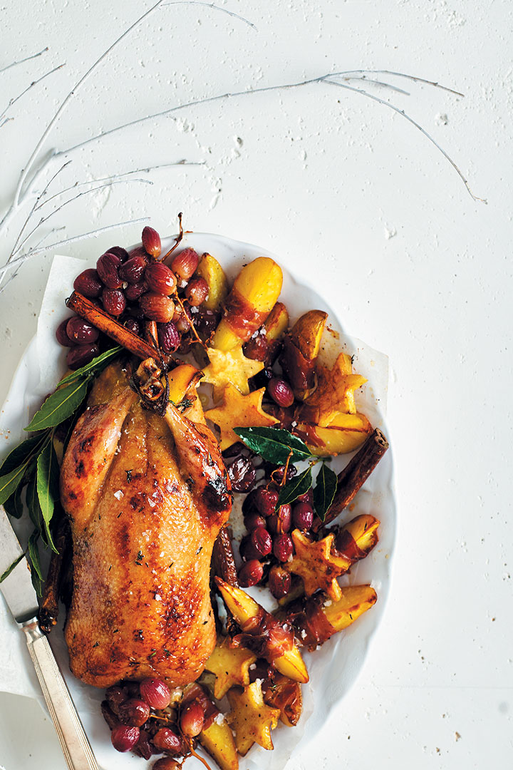 Honey-glazed duck with grapes and potato wedges recipe