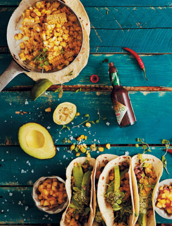 Flour soft-shell tacos with grilled corn, spiced black-eyed beans, cashew-nut cream and pineapple and chilli salsa