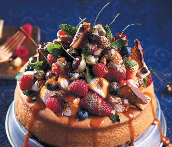 White chocolate and ginger baked cheesecake with caramel and golden berries