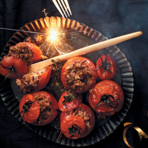 Whole roasted tomatoes stuffed with pecan nuts and goat's cheese