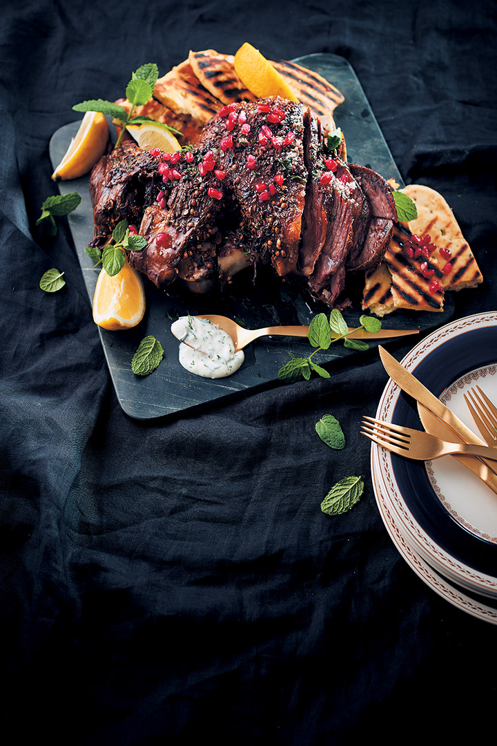 Spice-roasted lamb with mint pomegranate and lemon served with herbed yoghurt and flatbreads recipe