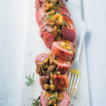 Fig, hazelnut and pesto-stuffed smoked pork fillet