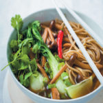 Soothing Asian broth with shimeji mushrooms and noodles