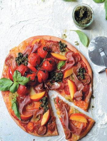 Spelt pizza with heirloom tomatoes, nectarine, prosciutto and kale pesto recipe