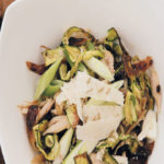 Warm baby marrow and roast chicken salad served with zesty vinaigrette and Parmesan shavings