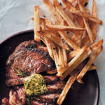 Pan-fried rib eye steak with herbed butter and skinny potato chips