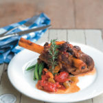 Braised lamb shanks in a rich tomato ragout