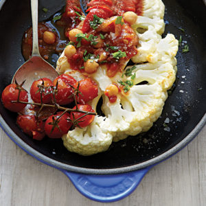 Cauliflower steaks with tomato and chickpea sauce