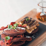 Double chocolate flapjacks with grilled bananas and crispy streaky bacon by Chef Alfred Henry