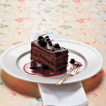 Chocolate mud cake with zesty berry compote