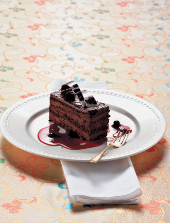 Chocolate mud cake with zesty berry compote recipe