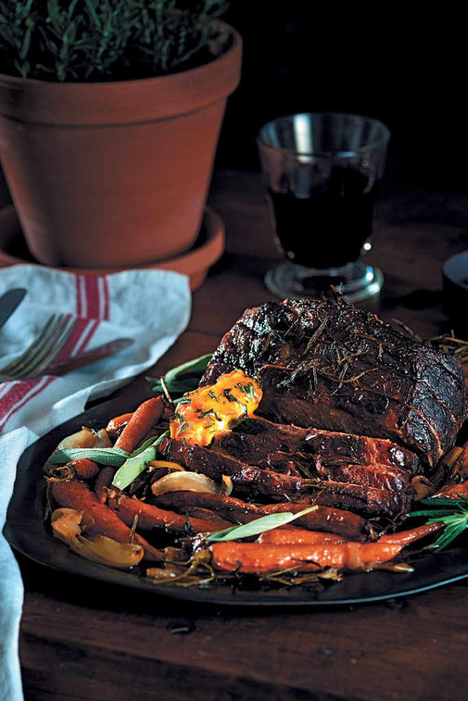 Roasted beef with relish-and-herb butter and sweet roasted baby carrots