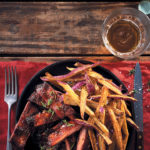 Whisky and maple sticky pork ribs with sweet potato fries