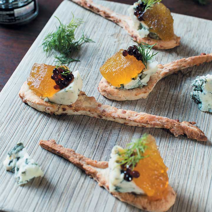 Crackerbread spoons with watermelon preserve, gorgonzola and balsamic caviar