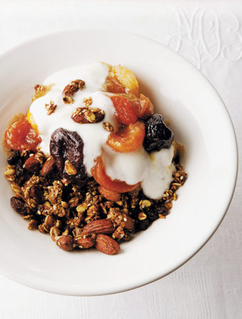 Homemade granola with stewed fruit and vanilla yoghurt