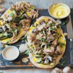 Spicy chicken baby marrow naan pizzas with coco-peanut sauce