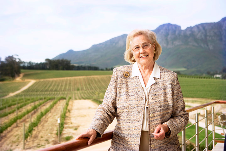 May De Lencquesaing, grande dame of Glenelly Estate in Stellenbosch The Lady May, Glenelly's flagship estate wine named in honour of Glenelly's Grande Dame, May-Eliane de Lencquesaing, is an exceptionally graceful and stylish Cabernet Sauvignon with a dash of other Bordeaux varieties. It is naturally fermented and matured in new French oak for 24 months. Elegant and complex, the wine develops flavours of cassis, blackcurrant, dark cherry, raspberries and delicate spicy plum. The wine displays an exquisite structure, seamless oak, velvety tannins and a silky savoury finish and has a very good aging capability of 12 to 18 years. A sculpture of Madame de Lencquesaing by Maxime Real del Sarte (1948), a wedding gift, is depicted on the Lady May wine label. This highly acclaimed Cabernet has received many prestigious awards, including a pinnacle 5-star rating for the 2009 vintage in Platter's wine guide. The 2011 Lady May received a 92 point rating in Wine Advocate, 93 points in Wine Enthusiast and 95 points in Tim Atkin's South African Report. Lady May 2012, with brand new packaging, will be released towards the end of 2017 The name and concept of the estate's flagship Cabernet remain the same. However, the new packaging makes for a stronger identity, incorporating gold foiling on a dark brown background with the handwriting of May de Lencquesaing. The capsule is gold tin and embossed.