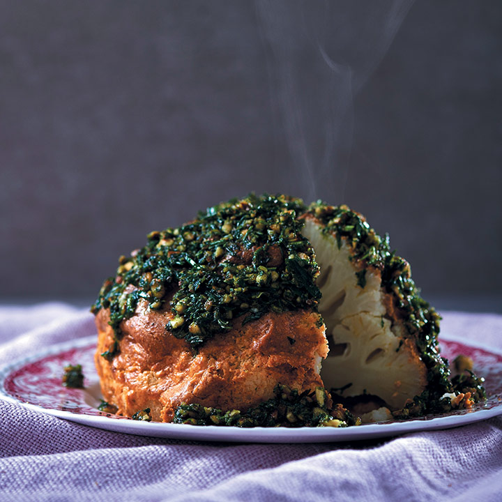 Whole spice and tahini roasted cauliflower with almond and herb pesto