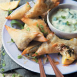 Mini rocket, walnut and goat's cheese spanakopitas with dill and lemon tzatziki