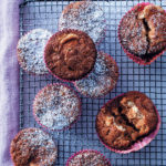Cinnamon, white chocolate, macadamia and cranberry cream-cheese-swirl muffins